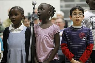 From left: Martha Lado, 5, Ramba Kubari, 6, and Daniel Rodriguez, 9, members of Status4, rehearse at Elmwood High School for a concert Friday night.