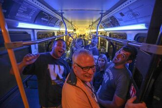 Bombers fans pile onto buses at the end of the first Winnipeg Blue Bombers game at Investors Group Field Wednesday. Transit director Dave Wardrop says officials thought 5,200 people would take the bus, but 8,500 showed up.