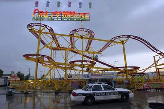 A police squad car at the Crazy Mouse at the Red River Exhibition after Thursday evening's accident.