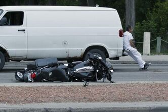 A man was transported to hospital after his motorcycle hit a van on Henderson Highway at Larsen Avenue on Monday.