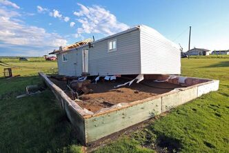 A home on the Sioux Valley Dakota Nation lies blown off of its foundation by a suspected tornado Thursday evening.