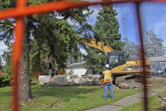 A crew takes down the foundation of one of 10 homes to be demolished in Pointe du Bois. Hydro is forging ahead despite residents' objections.