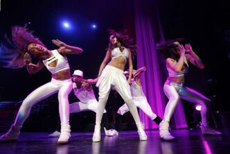 Selena Gomez's dancers bust moves at the MTS Centre Monday.