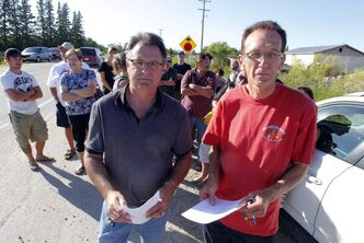 Al Prue (left) and Dennis Petaski at Thursday evening's rally against the sewage lagoon.