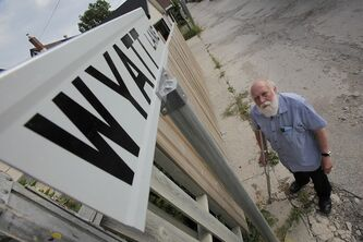 Winnipeg city councillor Harvey Smith stands near one of the signs he had installed in back lanes in his ward. Smith is upset at the condition of the lanes.