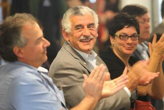 Peerless Garments CEO Albert El Tassi (centre) made a surprise announcement during Thursday's CEO Sleepout kickoff.