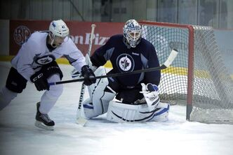At practice Monday, forward Jason Jaffray races to the puck in front of prospect Juho Olkinuora.