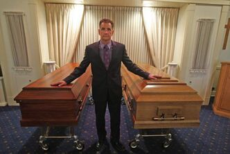 Kevin Sweryd, president and director of Bardal Funeral Homes with regular coffin, left, and oversized coffin for a oversized person.