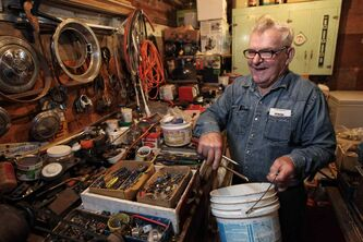 Bill Gregorchukloads his tools into an ice-cream pail.