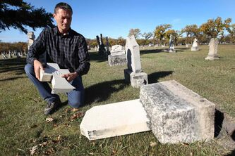Michel Michaud, caretaker at St. Boniface Cemetery, discovered late Friday that 25 grave markers had been knocked down and some had been destroyed by vandals.