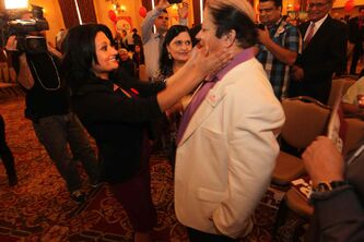 Rana Bokhari rushes to embrace her father, Syed Tahir Bokhari, as her mother, Yasmine Bokhari, watches Saturday at the Fort Garry Hotel. Rana Bokhari is the new leader of the Manitoba Liberal Party.