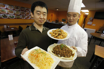 Yami Garden owner Guangyu Gong, left, with chef Jian Sun.