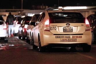A lineup of taxis stands at the ready for passengers at Richardson International Airport Tuesday. A court has ruled Manitoba's Taxicab Board must provide written reasons for revoking a taxi driver's licence.