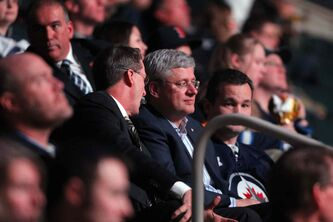 Prime Minister Stephen Harper talks with Jets owner Mark Chipman at the Jets game.