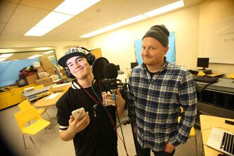Grade 10 student Dahlen Barron (left) and local rapper Pip Skid, who works with the youths in the program.