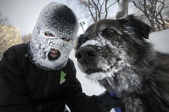 Reesa Simmonds and her dog, Xooom, on Wolseley Avenue during a 20-kilometre run Sunday.
