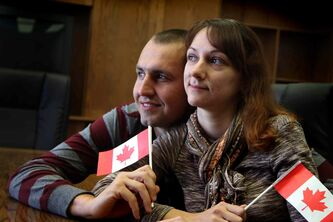 Anna Repina and Roman Plokhotniuk left Ukraine for a new life in Morden, thanks to a local immigration initiative.