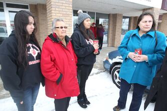 Kari Cobiness, Helen Cobiness, Brittany Cobiness and Andrea Camp (from left) were charged with violating an injunction banning Buffalo Point First Nation members from public spaces on the reserve.