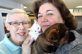 Carla Martinelli-Irvine (right), founder and director of the Winnipeg Pet Rescue Shelter with long-time volunteer Susan Murray (left) and a couple little cuddly guys ready for adoption.