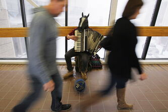 Blaine, the accordion-playing busker who wears a horse's head, is one of the skywalk stars before Winnipeg Jets games.