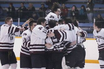 Adam Jones (30) and the St. Paul's Crusaders celebrate a 4-1 win over the River East Kodiaks in the AAAA Provincial High School Hockey Championship at St. James Civic Centre Monday night.