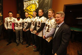 Brian Dobie was thrilled to unveil six local recruits for University of Manitoba Bisons, including (from left) Drenin Busch, Dane Douglas, Eric Plett, Anthony Dyck, Braedan Cheang and Riley Harrison.