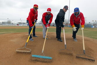 Wesmen baseball players Rory Mitchell (from left), Paul Esteves, Brendan Gaunt and Zach Campbell were busy getting the  Chalmers Community Centre field ready for Friday's home game.