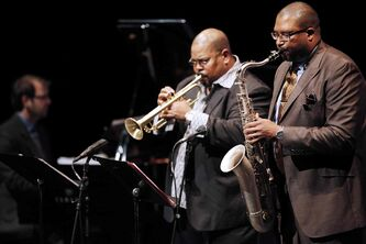 Jimmy Greene (R), father of Ana Grace Greene who died in the Sandy Hook Elementary School shooting on December 14, 2012, plays sax with Derrick Gardner (C) and Will Bonness at Jazzfest Monday, June 16, 2014.