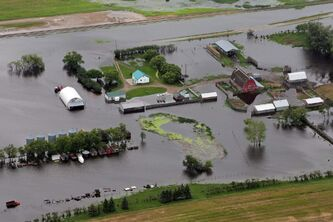 A flooded farm in western Manitoba is seen from the air Monday.