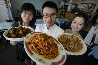 (L to R) Jing Feng wife of Leilei Du, owner/chef and waitress Ailang Hou of the Winnipeg Flying Noodle House.