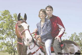 Tom Gardipy Jr. and his wife Cheryl. Family teamwork is a big part of the trainer's success at Assiniboia Downs.