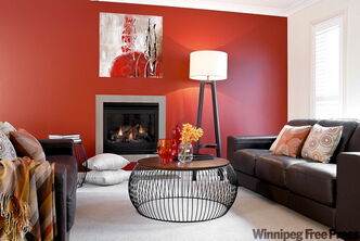 Eye-popping feature wall makes up for lack of knick-knacks in this feature living room.