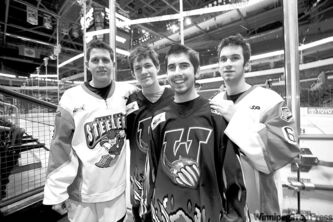 From left, Lars Meilleur with brother Jens, and Brett Gagnon with brother Derek before Tuesday's game at the MTS Centre.