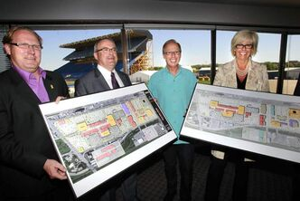 From left: Coun. Scott Fielding, Bob Downs, development manager with Shindico, Mayor Sam Katz and Deborah Green with Cadillac Fairview show a concept drawing of a redeveloped stadium site.