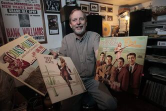 Harry Dyck, a collector of early country and bluegrass vinyl records, in the basement of his home in Carman.