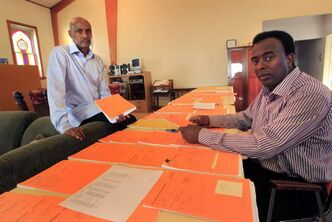 Local sponsors Marcus Askar (right) and Juhar Hargaaya, with dozens of files of African refugees with sponsors in Canada who've fled to Djibouti.