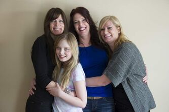 Sisters Nicole (from left), Tara and Krystal, with Nicole's daughter, Kate, 10. All three sisters are breast-cancer survivors.