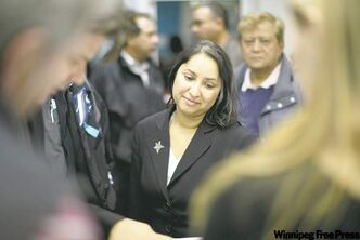 Devi Sharma meets with supporters.
