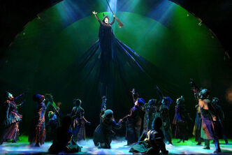 "Idina Menzel as Elphaba, the wicked witch, ""flies"" with her broom over pursuers at the Gershwin Theatre in New York, in this undated publicity photo from the musical Wicked"