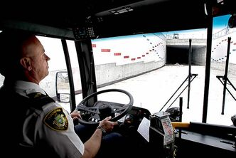 John Vagi drives the bus on a media tour of Winnipeg's rapid-transit line in south Winnipeg.