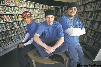 Stony Mountain inmates Lance Laquette (from left), Jeremy Garton and Fabian Twohearts in the prison school library. Below, Twoheards grabs a chair and sets up for class.