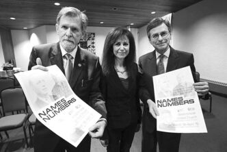 FROM LEFT: James Christie, Belle Millo and Rev. Robert Campbell with posters promoting exhibit.