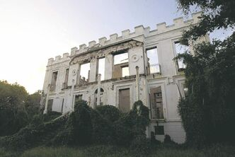 The gutted remains of former hotel, Sam Lord�s Castle, in St Philip, Barbados. The house was owned by Sam Lord in the 19th centruy.  It is said that he was a pirate, but there is some dispute regarding this. Below, Chattel houses at Chattel Village in Holetown, Barbados. Made of wood, they were traditionally built by plantation workers, most of them former slaves, on wooden blocks, instead of a buried foundation.  The Chattel Village was made to lure tourists, and is a cluster of souvenir and craft shops and restaurants.
