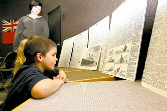 Gordon Taylor, 5, looks at copies of the Manitoba Free Press after watching a presentation about the sinking of the Titanic at the Manitoba Museum.