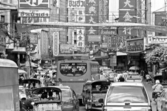 The clean, broad streets of downtown Bangkok are choked with traffic.