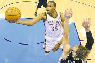 Small forward Kevin Durant (35) shoots over San Antonio Spurs center Tiago Splitter (22).