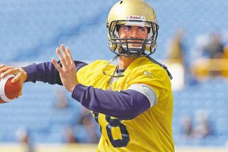 KEN GIGLIOTTI  / WINNIPEG FREE PRESS archives Quarterback Justin Goltz winds up for a throw at Bombers camp in Canad Inns Stadium. He's competing for a backup job with the club in the regular season.