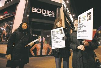 Judith Cheung (from left), Cathy Rocke and Maria Cheung protest outside Bodies: The Exhibition in November 2010 with a petition to close it down.