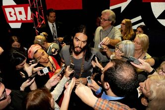 Russell Brand is a tad cheeky with reporters.