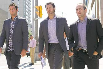 Brian Elliott of the St. Louis Blues, L.A. Kings' Kevin Westgarth and Florida Panthers' Mike Weaver (from left) exit the NHLPA offices in Toronto on Thursday.